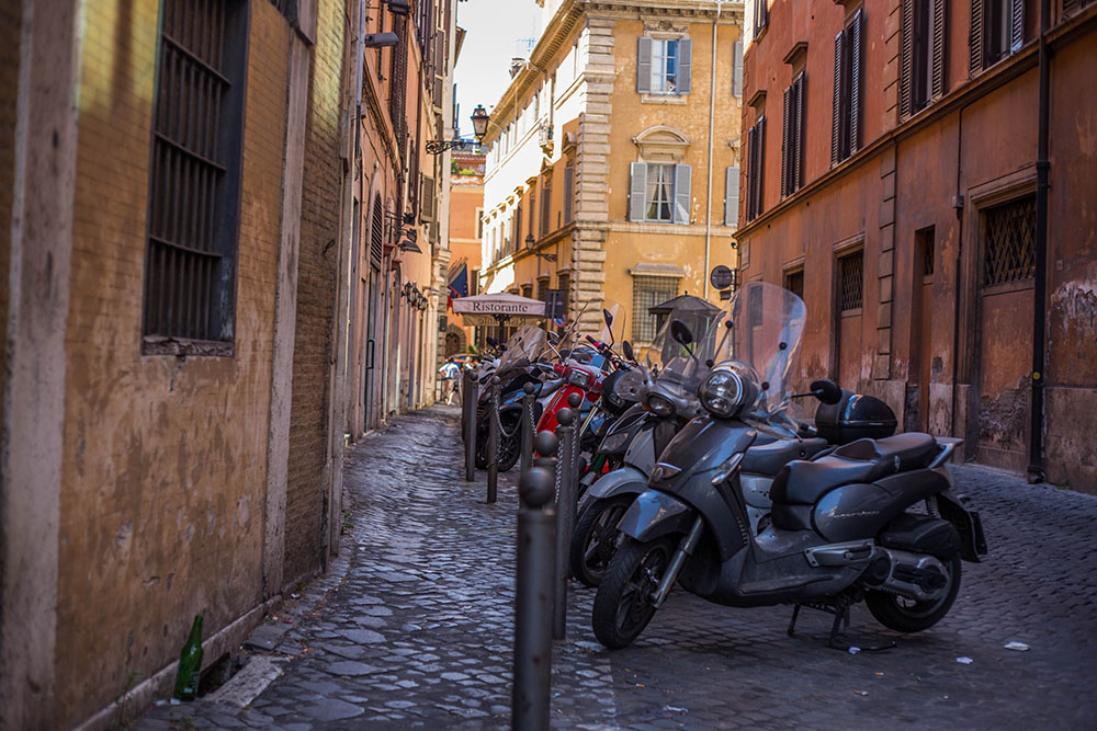 rome; italy; rome streets; rome skyline; rome attractions,banksy art in Rome, Colosseum, how to get to rome, Leonardo express, Palatine, pantheon, PIAZZA NAVONA, pinocchio, The Roman Forum, Torre Argentina Cat Sanctuary, Trevi fountain, Via del Corso, when to see trevi, where to go in Rome,La Pizza del Teatro, Gelateria del Teatro
